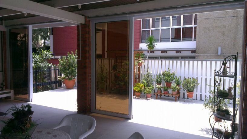 Aluminium top hung sliding glass door spacedor marketing for Hanging sliding glass doors