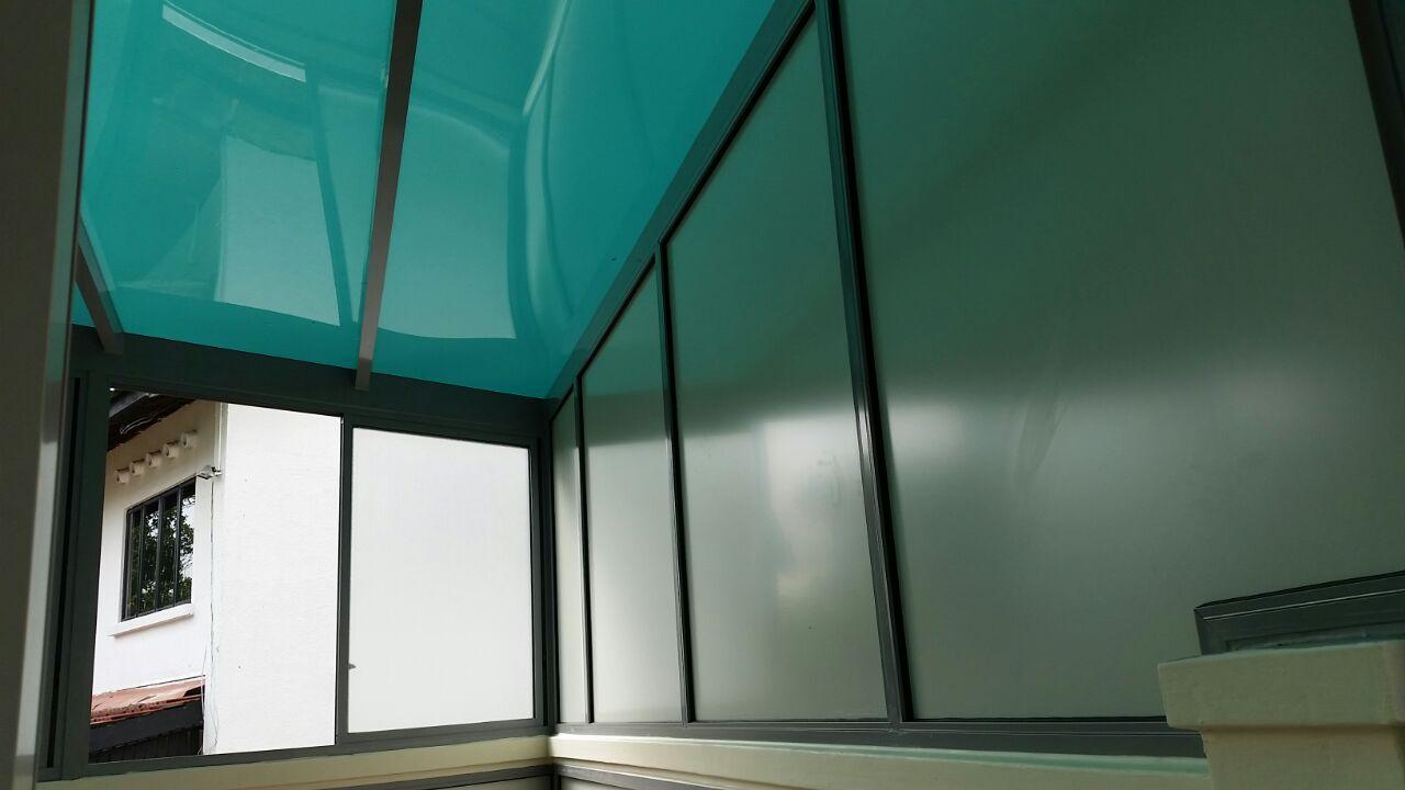 Powder Coated Windows : Polycarbonate shelter and sliding glass window at back yard