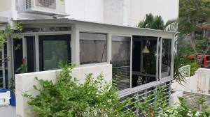 Enclosed Balcony with Aluminium Composite Panel and Sliding Window and Swing Door 2