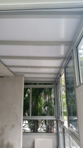 Enclosed Balcony with Sliding Window, Swing Door and Polycarbonate Shelter